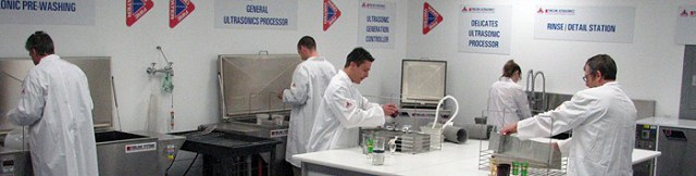 Technicians at work in the lab using the Fireline Ultrasonic cleaning system